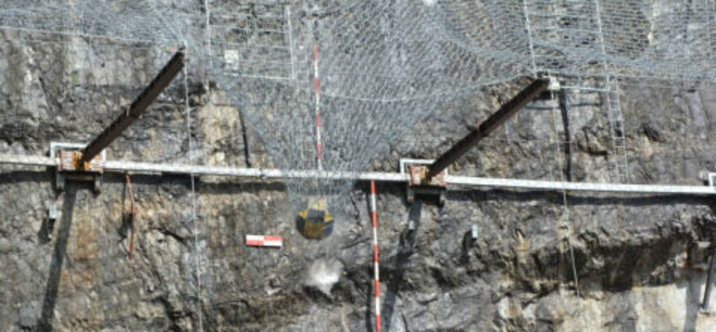 Geobrugg live tests flexible rockfall protection canopy