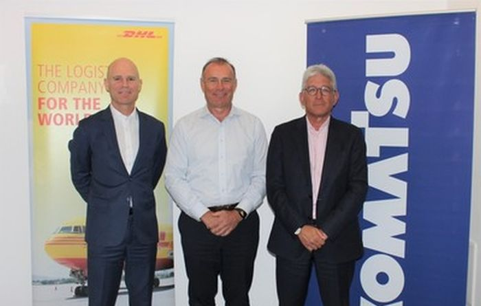 Representatives of DHL and Komatsu at the inking of their partnership deal