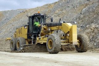 Cat 18M3 motor grader dresses haul road