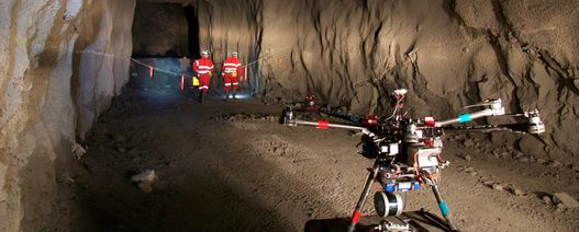 Mapping the underground with drones, legged robots